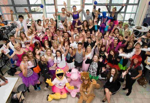 GROUP EFFORT: Pupils and staff at Poole High School dress up as ballerinas and ballroom dancers