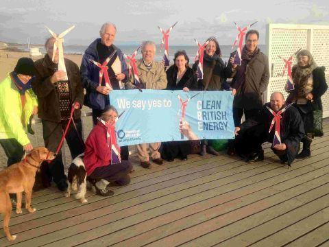 WINDY: Members of Friends of the Earth gather at Bournemouth seafront to promote debate over the proposed windfarm off the coast. Below, Andy Atkins, executive director of Friends of the Earth