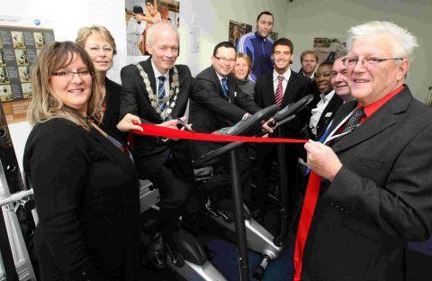 OPEN:  Mayor of Bournemouth Cllr Phil Stanley-Watts cuts the ribbon to open the new gym at the Hope Housing Training and Support centre at St Swithuns Road