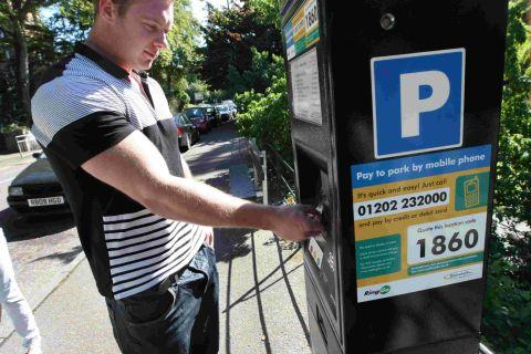 JUST IN CASE: Scott Major using a parking meter in Bourne Avenue, Bournemouth, even though enforcement has come to a grinding halt