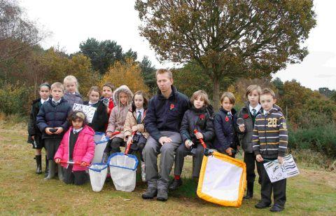 FED-UP: Children from Hill View Primary School, with teacher Chris Barnett, at Redhill Common