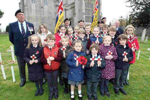 TRIBUTE: Children from Priory School in Christchurch join the Royal British Legion at the Priory to lay a wreath and crosses at the Garden of Remembrance