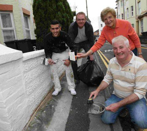 COMMUNITY PROJECT: Purbeck road residents, Bart Angus-Hughes, right, Aitor Villada, left, Stewart Mabe and Kathleen Challis who have been smartening up the appearance of houses in the town