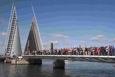 SUNNY DAYS: Poole residents took the opportunity of walking on the new Twin Sails bridge during the community weekend after it first opened