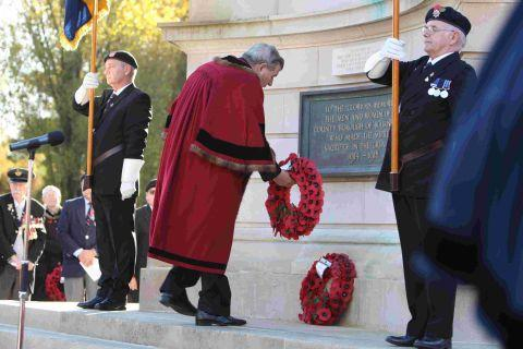 Bournemouth Echo: Deputy mayor Cllr Chris Rochester lays a wreath at Bournemouth's war memorial. Picture: Richard Crease