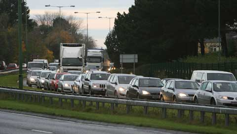 Broken down car towing caravan causes A31 delays. File picture.