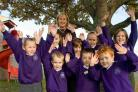 IMPRESSIVE: Pupils at Bovington Primary School, together with their headteacher, Juliet Muir. Picture: Jon Beal