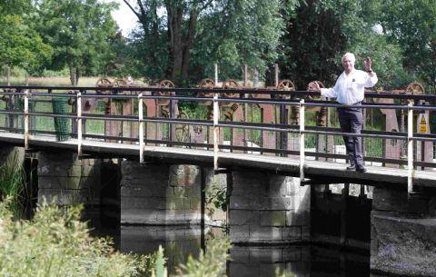 WHAT'S IN A NAME? Cllr Ron Whittaker on the wier bridge at Throop Mill