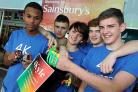 FOR KYLE: Friends of Kyle Rees, inset, sell their charity wristbands and ladybugs in his memory at Sainsbury's Castlepoint. Pictured from left are Ellis Reeves, Louis Rylance, Sintija Morgan, Dan May and Reece McAneny