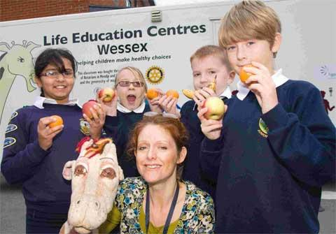 CHOICES: Vicki Solly, educator for the Wessex Life Education Centre, with students from Queens Park Academy. Picture: Jon Beale