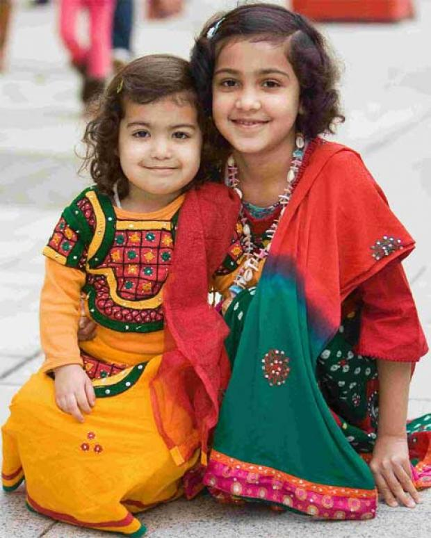 TRADITION: Aadya Singh, with her sister, Arohi