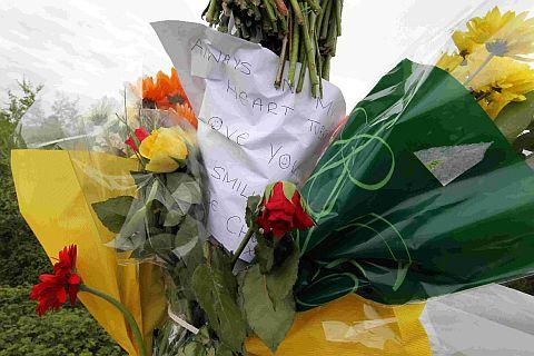 RESPECTS: Floral tributes to Michael Walker adorn a lamppost on Holes Bay Road