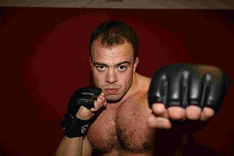 PEEKABOO: Fighter Sam Boo will be taking on Alex Reid on December 1 Picture: UK Dragon Photos
