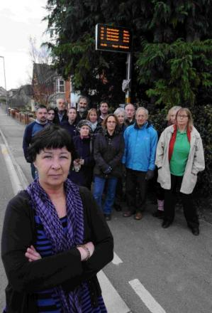 STRANDED: Mary Ann Carson and angry  residents in Dorchester Road