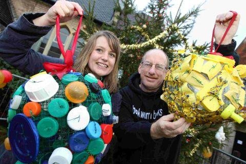 Matilda Bark, of Dorset Coast Forum, and Richard Wilson, chairman of Ashley Road Traders Association, with the baubles made from litter found on beaches