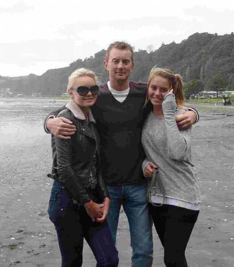 HAPPIER DAYS: Mark Longley with his daughters Emily, left and sister Hannah
