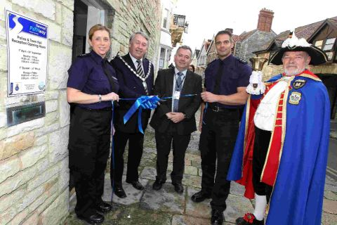 CEREMONY: Tracey Baker, Mayor of Swanage Cllr Bill Trite, Commissioner Martin Underhill, Insp Chris Weekes and the town crier open the new Swanage Pathway police office