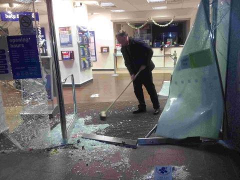 Out of control car crashes into building society office