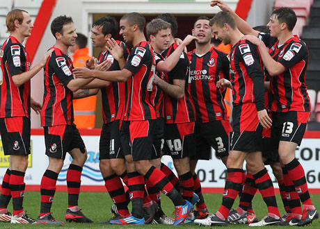 WINNER: Cherries celebrate Lewis Grabban's goal on Saturday