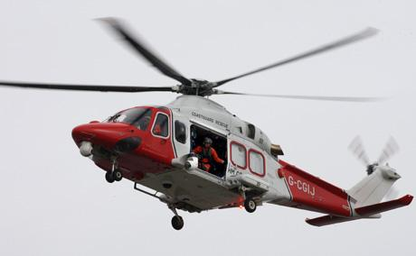 SEARCH: The coastguard helicopter in the air earlier today