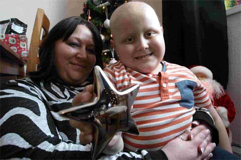 A BRAVE BOY: Alfie Roberts with his Little Star Award at his home in Oakdale with his mother Clair. Picture: Corin Messer