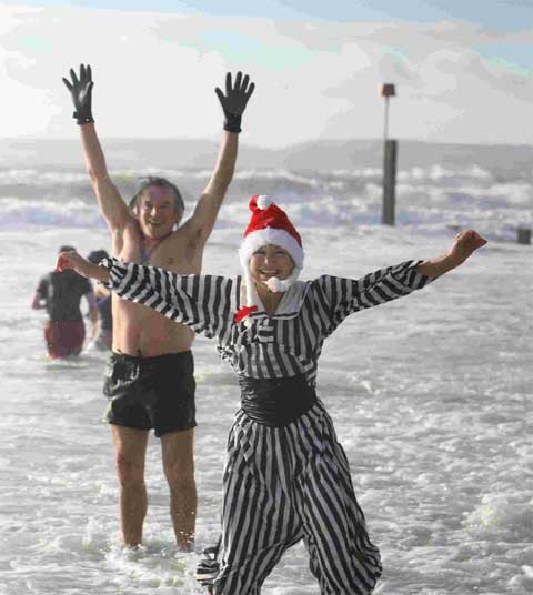 Spartans young and old join in Christmas Day swim