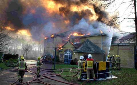 INFERNO: Dorset Fire and Rescue at the scene of a fire that engulfed the arts block and Gainsford Theatre at Lytchet Minster School. Picture: Richard Crease