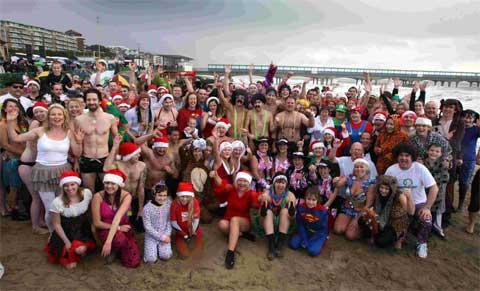 FUNDRAISING FUN: Above, people pose for a picture on Boscombe beach.