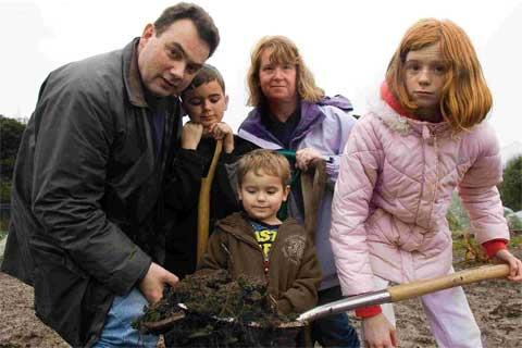 'TERRIBLE NEWS': Allotment owner Ken Fanner, pictured with his family, is angry over council plans to evict him from his allotment in Longham Allotment Gardens. Picture: Jon Beal