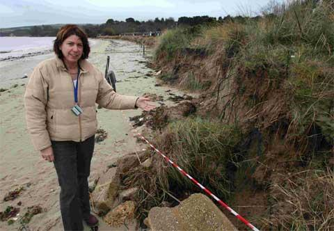 File picture: Emma Wright, above, operations manager for the National Trust Studland, beside the erosion-riddled beach in December