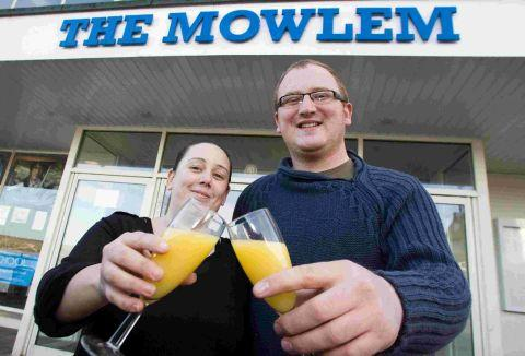 CHEERS: Chris Wood and partner Steph Turley celebrate outside the Mowlem Theatre