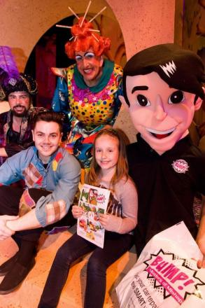 OH YES SHE DOES: Charlotte Tonks receives goodies from Tim Flavin, Don Maclean and, front, Ray Quinn, together with BUMP! mascot Master of Mishaps. Picture: Jon Beal