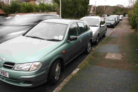 PASSING: Traffic overtakes parked vehicles on North Road in Poole