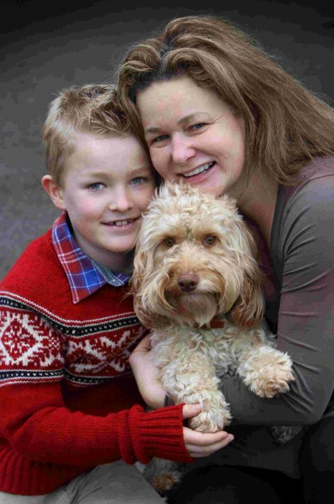 INCREDIBLE JOURNEY: Alfie is back in the arms of his owners Emma Wimhurst and son Charlie after going missing for ten days