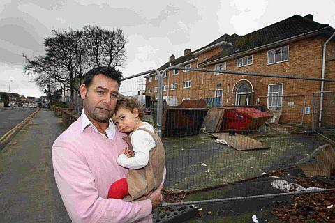 UNFAIR: Residents are not happy with the new supermarket plans including Daniel Newsum, pictured, holding daughter Amelia, who lives opposite the former police station