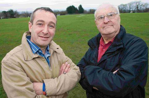 DELIGHTED: Lytchett Matravers Sports Club chairman Steve Reid, left, with secretary Peter Ashton