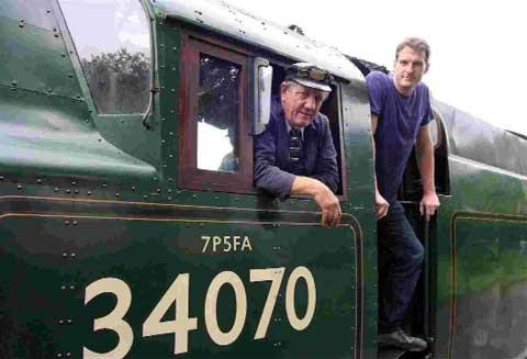 FULL STEAM AHEAD: Driver Tony Hallworth and Dan Snow at the railway