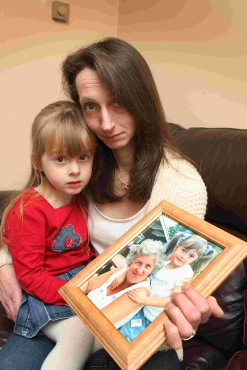 POIGNANT: Sue Pinfield-Wells and daughter Rhiannon with a photograph of her mum Eileen who died last year after suffering