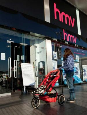 A customer reads the sign outside HMV at Castlepoint