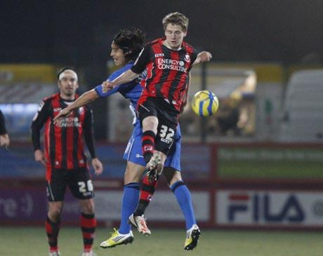 UP FOR THE CUP: Eunan O'Kane wins a header