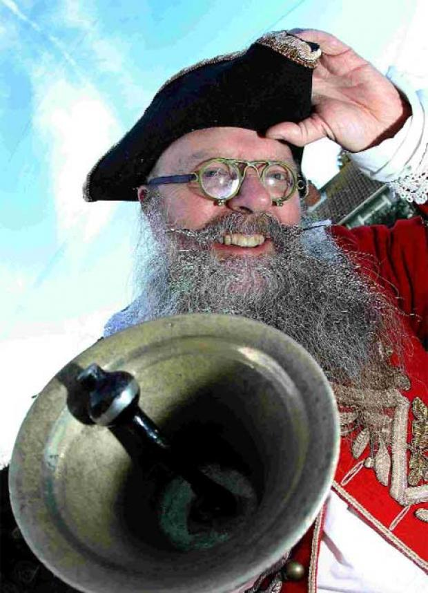 Wimborne Town Crier Chris Brown with his bell that he had stolen last year but was reunited with two weeks later when a kind soul dropped it off in his driveway allowing Chris to alert people to the news