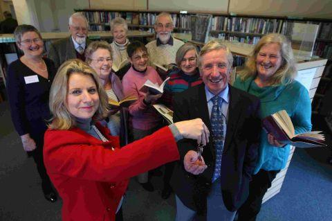 PRESENTATION: Dorset County Council chief executive Debbie Ward presents the keys to Friends of Wool Library chairman David Smith and library volunteers