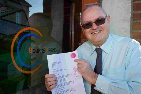 SOLVED: Founder Martin Broad outside the Bourne Spring Centre with a letter from the Big Lottery Fund announcing his successful bid