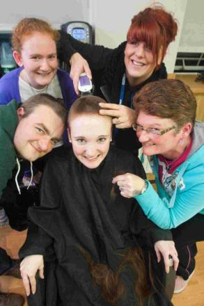 CUTTING EDGE: Hannah Smith with brother Mark Trott, sister Heidi Smith, salon instructor Charlie D'Amico, and mum Debbie Gimson at Flaunt Salon on Lansdowne Campus