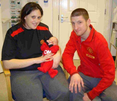Sinead and Martin Mellor with new arrival Kyran