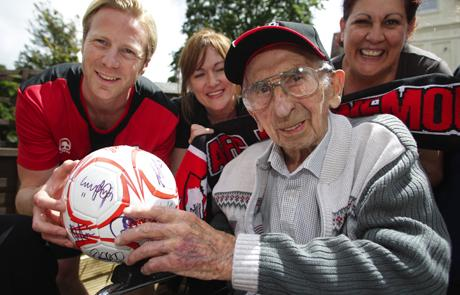 OFF-FIELD WORK: Mark Molesley presenting a signed ball to life-long Cherries fan Philip Young on the eve of his 99th birthday in 2010