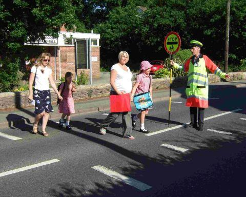 Bournemouth Echo: HELPING HAND: Lollipop man, Peter Walker, on Station Road in West Moors