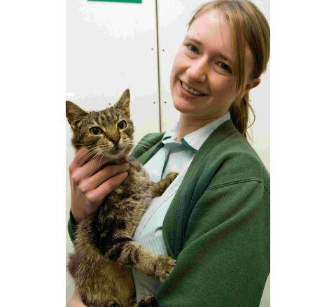 Veterinary nurse Sam Rogers with the cat