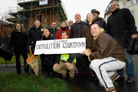 DELIGHT: Chris Colledge, right, with Whitelock property manager Josh Whitelock, front centre, and members of the West Cliff Residents' Association outside of the former St George's Hotel, now being demolished and redeveloped