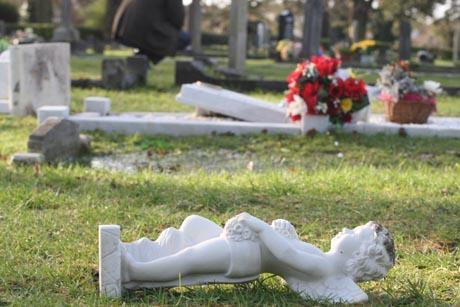 SHOCKING: Some of the graves targeted at Poole cemetery